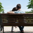 Young couple on bench — Stock Photo #9559540