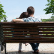 Stock Photo: Young couple on bench