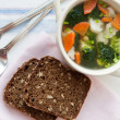Healthy soup with wholemeal bread — Photo