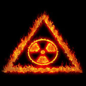 Burning nuclear danger sign — Stock Photo