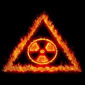 Bruciando il segno del pericolo nucleare — Foto Stock