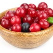 Fresh berries in a wooden plate — Stock Photo #8028143