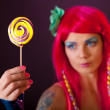 Girl with pink hair holding lollipop — Stock Photo #10729890
