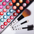 Colorful lip gloss palette with set of brushes - Stock Photo