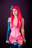 Young woman dressed in bright latex clothes — Stockfoto