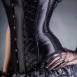 Close-up shot of elegant woman in black corset — Stock Photo