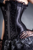 Close-up shot of elegant woman in black corset — 图库照片