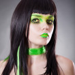 Portrait of attractive woman with green make-up — Stockfoto
