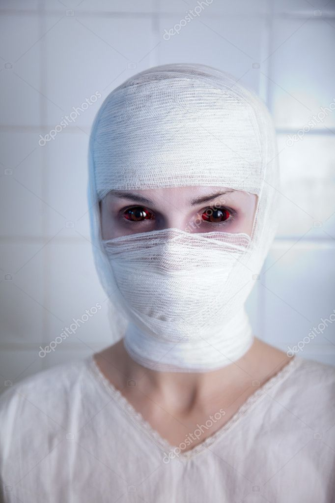 Victim of genetic experiment, girl wrapped in bandage, real contact lenses — Stock Photo #9972024