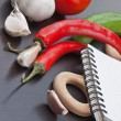 Notebook for cooking recipes and vegetables — Stock Photo #10064499