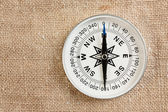 Compass on old canvas — Stock Photo