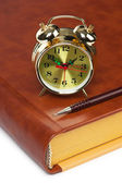 Golden alarm clock on the book isolated — Stock Photo