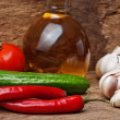 Glass bottle with spices and vegetables — Stock Photo #7977278
