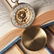 Compass and old books — Stock Photo