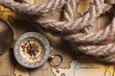 Compass and rope on map — Стоковое фото