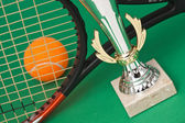 Sports awards and tennis racquets — Stock Photo