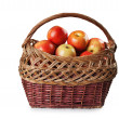 Apples in a wicker basket — Stock Photo