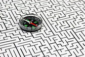 Compass on background of the labyrinth — Stok fotoğraf