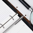 Pen, magnifying glass and diary — Stock Photo