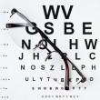 Glasses on eyesight test chart — Stock Photo #8354066