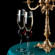 Two glasses of wine and a candlestick — Stock Photo