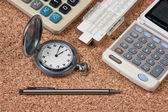 Pocket watch, calculator and slide rule — Stockfoto