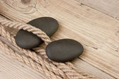 Pebble and rope — Stock Photo