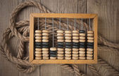 Old abacus and rope — Stockfoto