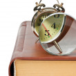 Stock Photo: Golden alarm clock and magnifying glass on the book isolated