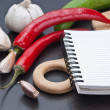 Notebook for cooking recipes and vegetables — Stock Photo #8552316