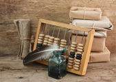 Pile parcel and abacus — Stock Photo