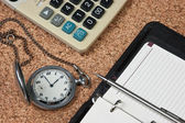 Pocket watch and calculator — Stockfoto