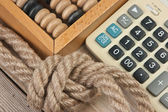 Calculator and old wooden abacus — Stockfoto