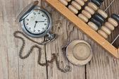 Pocket watch, abacus and stamp — Stockfoto