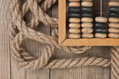 Old abacus and rope — Stock Photo