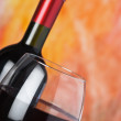 Bottle and a wine glass with red wine — Stock Photo