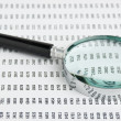 Magnifying glass and document with figures — Stock Photo #8773758