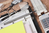 Notebook and office supplies — Stock Photo
