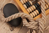 Old abacus and rope on wooden table — Stock Photo
