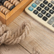 Royalty-Free Stock Photo: Calculator and old wooden abacus