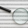 Magnifying glass and document with figures — Stock Photo #8990304