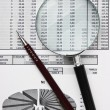 Magnifying glass and working paper — Stock Photo #8990314