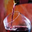 Red wine being poured into wine glass — Stock Photo