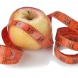 Measure tape and apple isolated — Stock Photo