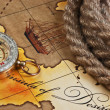 Compass and rope on map — Stockfoto #9679898