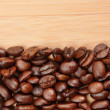 Royalty-Free Stock Photo: Coffee beans on a wooden background