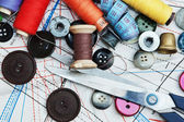 Various sewing accessories in the scheme — Stock Photo