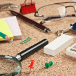 Office supplies in a mess on the table — Stock Photo