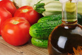 Vegetables and a bottle of oil, still life — Stock Photo
