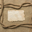 Royalty-Free Stock Photo: Old paper and rope on canvas